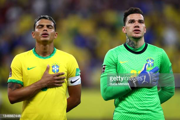 Thiago Silva and Ederson of Brazil sing the national anthem prior to a match between Brazil and Uruguay as part of South American Qualifiers for...