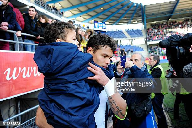 Thiago Silva and his son celebrate PSG winning their fourth consecutive Ligue 1 title after the French Ligue 1 match between ESTAC Troyes and Paris...