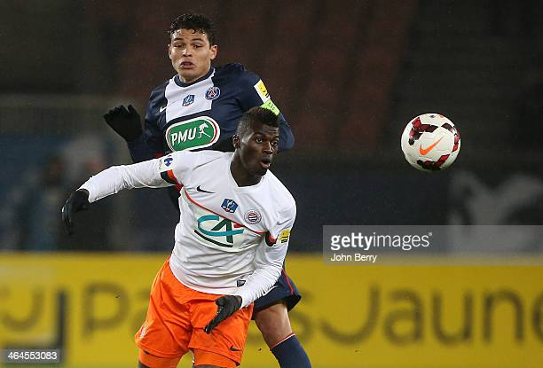 Thiago Silva and M'Baye Niang of Montpellier in action during the French Cup match between Paris SaintGermain FC and Montpellier HSC at the Parc des...