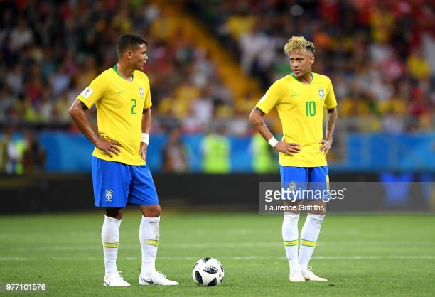 Thiago Silva and Neymar Jr of Brazil talk as they line up a freekick during the 2018 FIFA World Cup Russia group E match between Brazil and...