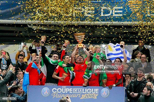 Thiago Silva captain of Paris SaintGermain FC lifts up the Coupe de la Ligue Trophy with Javier Pastore Salvatore Sirigu Marquinhos Lucas Serge...