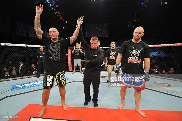 Thiago Silva celebrates after defeating Matt Hamill in their light heavyweight bout during the UFC Fight Night event at the Ginasio Jose Correa on...