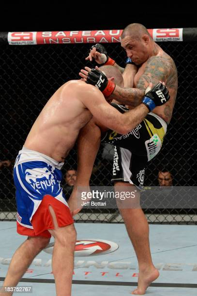 Thiago Silva lands a knee to the body of Matt Hamill in their light heavyweight bout during the UFC Fight Night event at the Ginasio Jose Correa on...