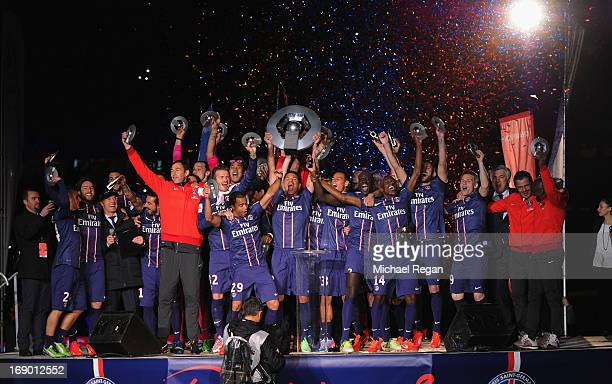 Thiago Silva lifts the Ligue 1 trophy after the Ligue 1 match between Paris Saint-Germain FC and Stade Brestois 29 at Parc des Princes on May 18,...