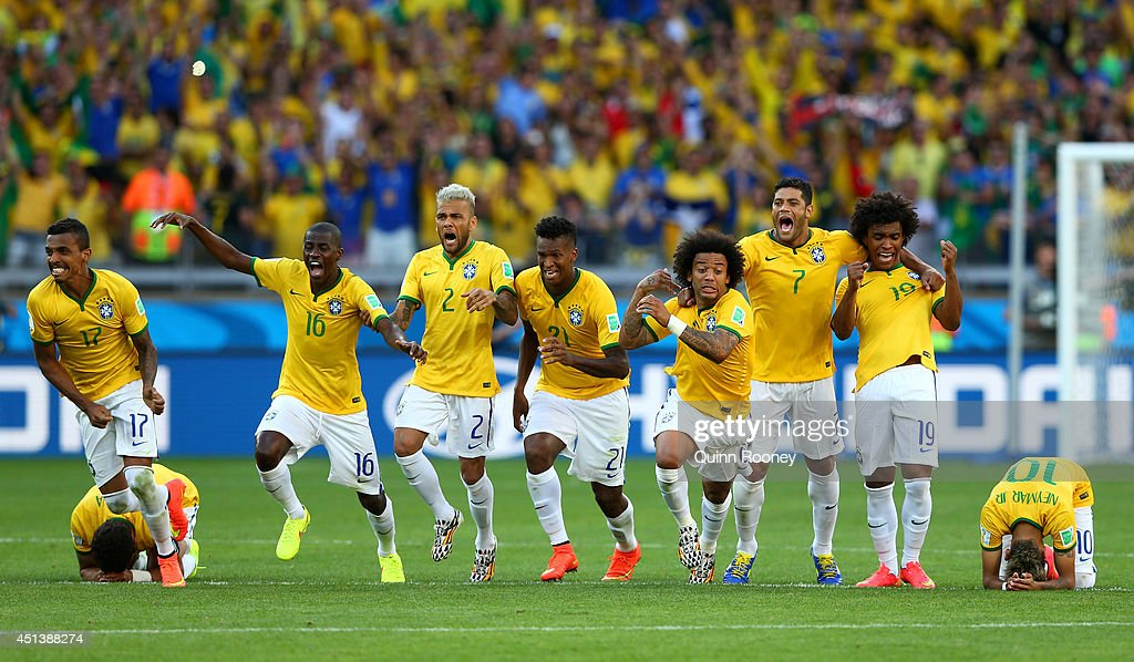 Thiago Silva, Luiz Gustavo, Ramires, Dani Alves, Jo, Marcelo, Hulk, Willian and Neymar of Brazil celebrate after defeating Chile in a penalty shootout during the 2014 FIFA World Cup Brazil round of 16 match between Brazil and Chile at Estadio Mineirao on June 28, 2014 in Belo Horizonte, Brazil.