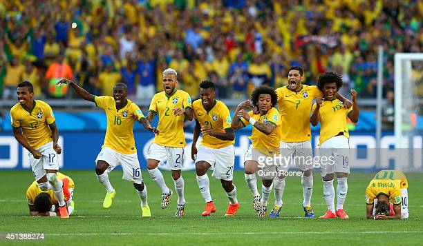 Thiago Silva Luiz Gustavo Ramires Dani Alves Jo Marcelo Hulk Willian and Neymar of Brazil celebrate after defeating Chile in a penalty shootout...