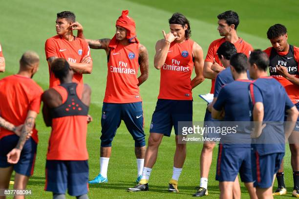 Thiago Silva Neymar Jr Edinson Cavani and Javier Pastore of Paris SaintGermain listen to the Coach before a Paris SaintGermain training session at...