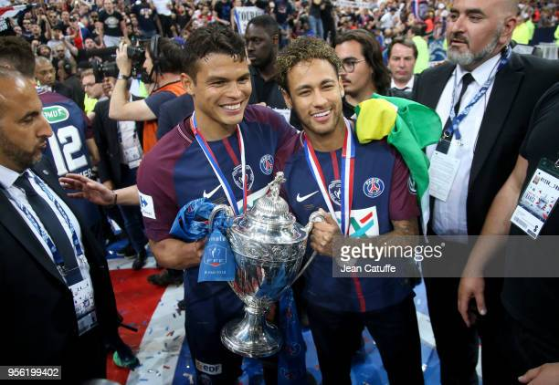 Thiago Silva Neymar Jr of PSG celebrate the victory following the French Cup final between Les Herbiers VF and Paris SaintGermain at Stade de France...