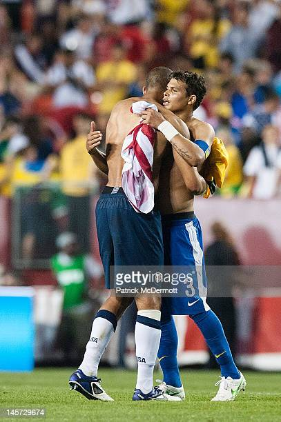 Thiago Silva of Brazil and Oguchi Onyewu of USA hug after an international friendly game at FedExField on May 30 2012 in Landover Maryland