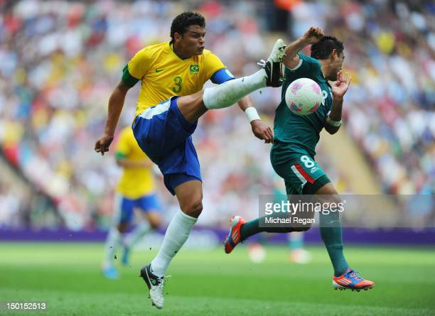 Thiago Silva of Brazil battles for the ball with Marco Fabian of Mexico during the Men's Football Final between Brazil and Mexico on Day 15 of the...