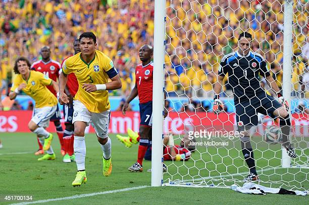 Thiago Silva of Brazil celebrates after scoring his team's first goal past David Ospina of Colombia during the 2014 FIFA World Cup Brazil Quarter...