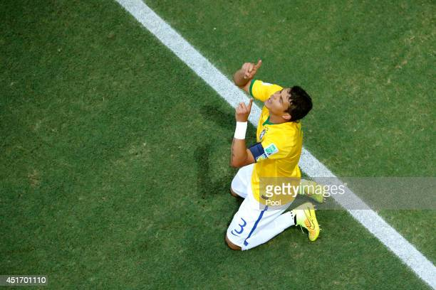 Thiago Silva of Brazil celebrates scoring his team's first goal during the 2014 FIFA World Cup Brazil Quarter Final match between Brazil and Colombia...