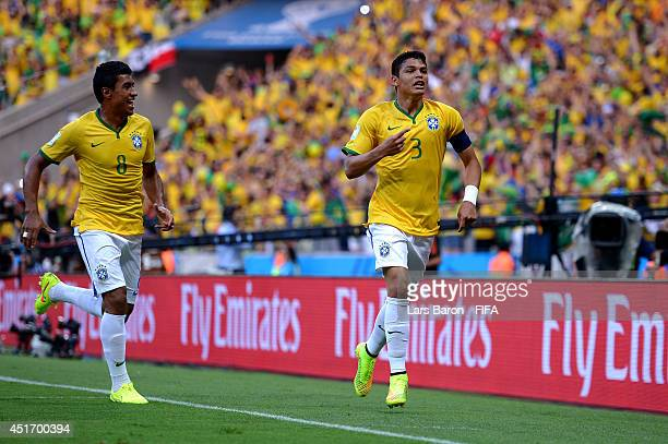 Thiago Silva of Brazil celebrates scoring his team's first goal with his teammate Paulinho during the 2014 FIFA World Cup Brazil Quarter Final match...