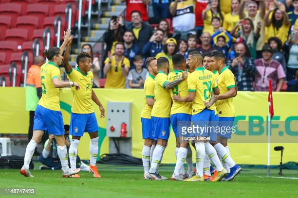 Thiago Silva of Brazil celebrates with his teammates after scoring the second goal of his team during the match Brazil v Honduras, at Beira-Rio...