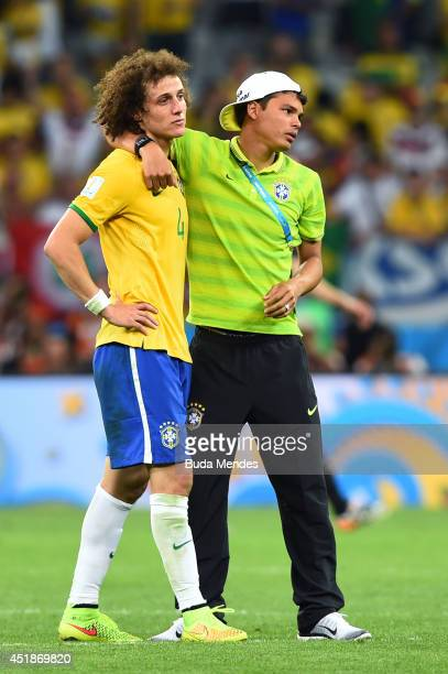 Thiago Silva of Brazil consoles David Luiz after Germany's 71 victory during the 2014 FIFA World Cup Brazil Semi Final match between Brazil and...
