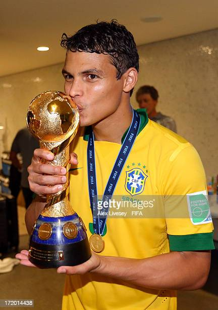 Thiago Silva of Brazil kisses the trophy in the dressing room at the end of the FIFA Confederations Cup Brazil 2013 Final match between Brazil and...