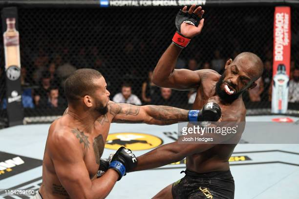 Thiago Silva of Brazil knocks out the mouthpiece of Jon Jones in their UFC light heavyweight championship fight during the UFC 239 event at TMobile...