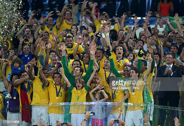 Thiago Silva of Brazil lifts the trophy with his teammates following their victory at the end of the FIFA Confederations Cup Brazil 2013 Final match...