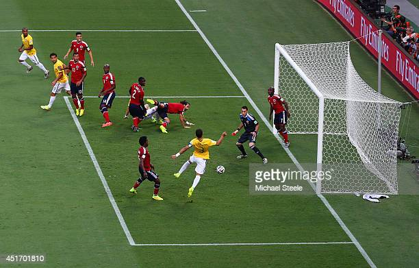 Thiago Silva of Brazil scores his team's first goal past David Ospina of Colombia during the 2014 FIFA World Cup Brazil Quarter Final match between...
