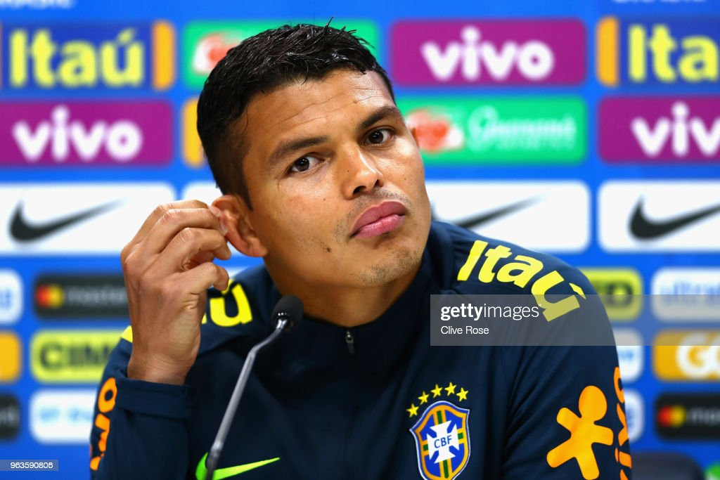 Thiago Silva of Brazil speaks to the media during a Brazil press conference ahead of the international friendly between Brazil and Croatia at Tottenham Hotspur Training Centre on May 29, 2018 in Enfield, England.