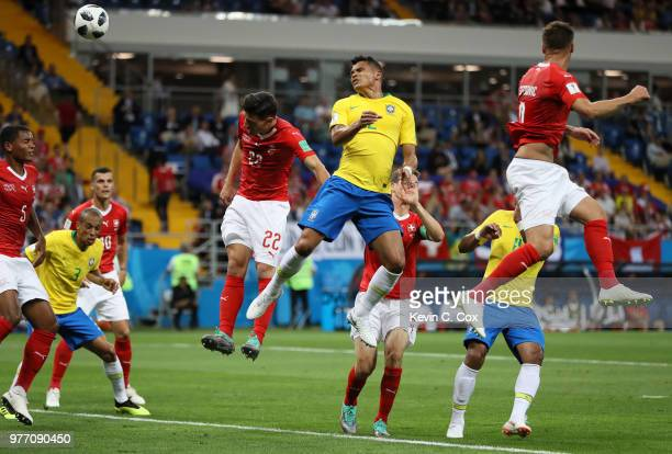 Thiago Silva of Brazil wins a header ahead of Fabian Schaer of Switzerland during the 2018 FIFA World Cup Russia group E match between Brazil and...