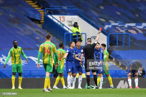 Thiago Silva of Chelsea and teammates Jorginho and Cesar Azpilicueta argue with match referee David Coote after he is shown a red card during the...