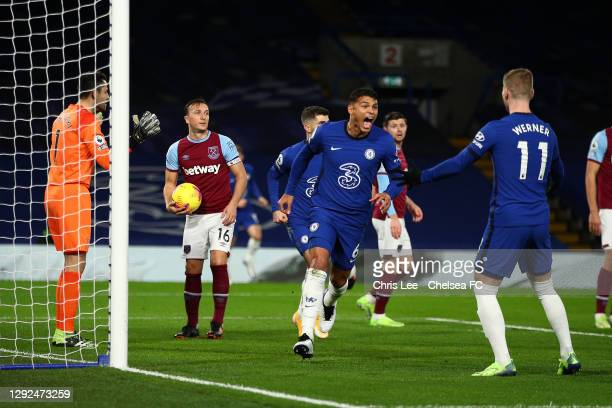 Thiago Silva of Chelsea celebrates with teammate Timo Werner after scoring their team's first goal during the Premier League match between Chelsea...
