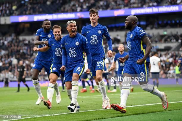 Thiago Silva of Chelsea celebrates with teammates Romelu Lukaku and Kai Havertz of after scoring their team's first goal during the Premier League...