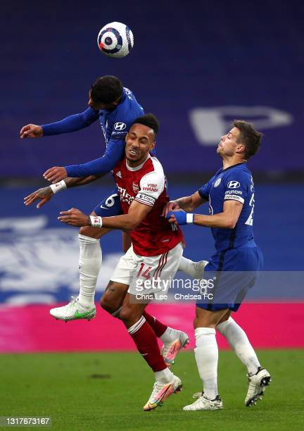 Thiago Silva of Chelsea competes for a header with Pierre-Emerick Aubameyang of Arsenal during the Premier League match between Chelsea and Arsenal...