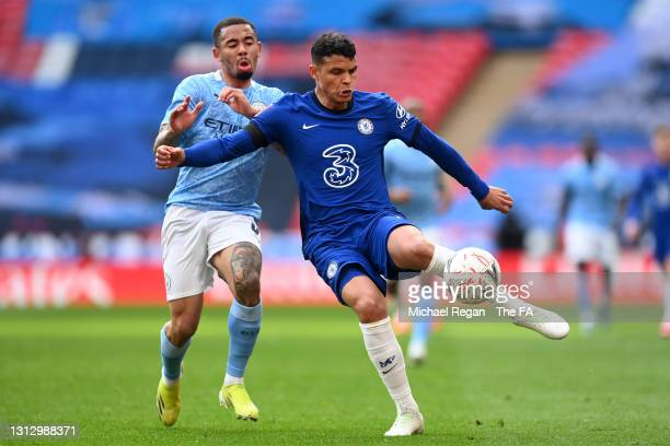 Thiago Silva of Chelsea is put under pressure by Gabriel Jesus of Manchester City during the Semi Final of the Emirates FA Cup match between...