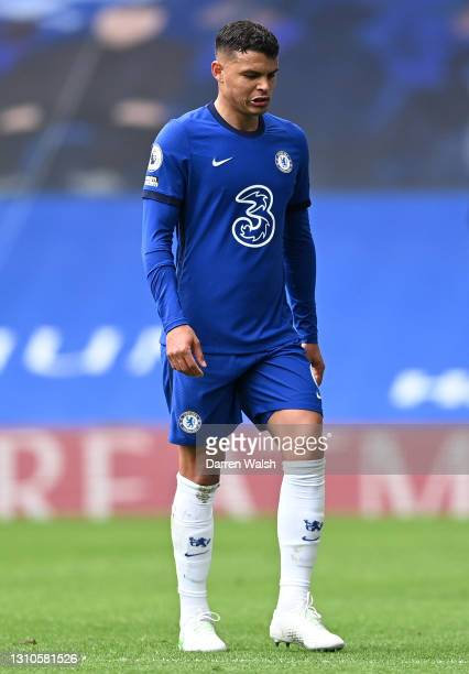 Thiago Silva of Chelsea looks dejected as he leaves the pitch after being sent off during the Premier League match between Chelsea and West Bromwich...