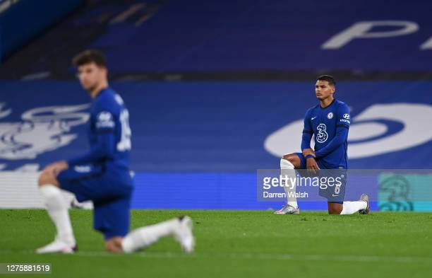 Thiago Silva of Chelsea takes a knee in support of the Black Lives Matter movement during the Carabao Cup third round match between Chelsea and...