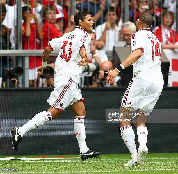 Thiago Silva of Milan celebrates with teammate Oguchi Onyewu after scoring 10 during the Audi Cup tournament final match for the third place Boca...