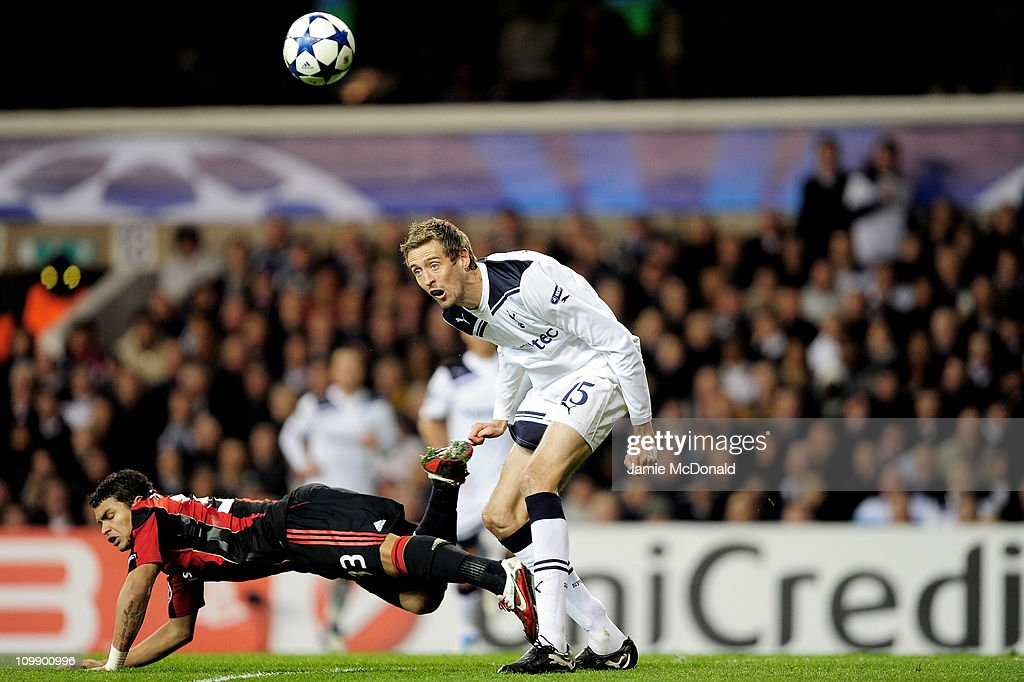 Thiago Silva (L) of Milan vies for the ball with Peter Crouch of Tottenham during the UEFA Champions League round of 16 second leg match between Tottenham Hotspur and AC Milan at White Hart Lane on March 9, 2011 in London, England.