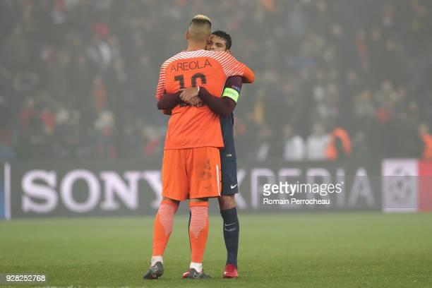 Thiago Silva of Paris Saint Germain congrats Alhonse Areola after the UEFA Champions League Round of 16 Second Leg match between Paris SaintGermain...