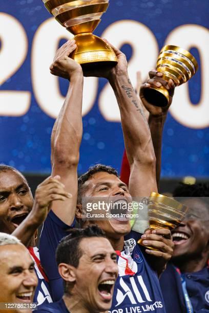 Thiago Silva of Paris Saint Germain holds up the trophy after winning the French League Cup final between Paris Saint Germain and Olympique Lyonnais...