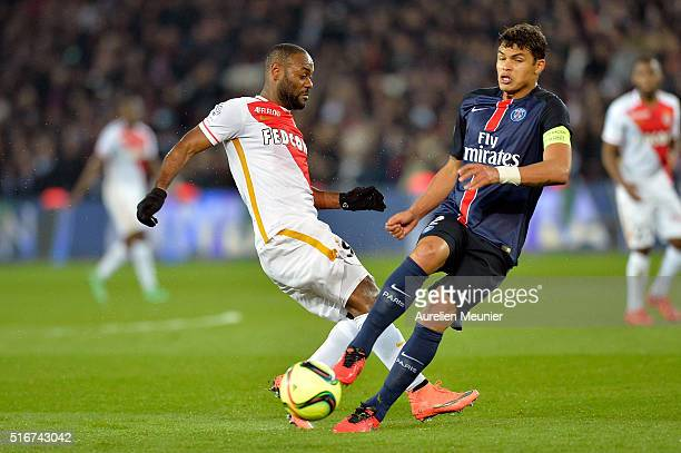 Thiago Silva of Paris SaintGermain and Vagner Love of AS Monaco fight for the ball during the French Ligue 1 match between Paris SaintGermain and AS...