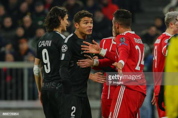 Thiago Silva of Paris SaintGermain argues with Corentin Tolisso of Bayern Muenchen during the UEFA Champions League group B match between Bayern...