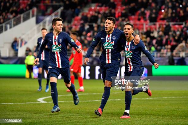 Thiago Silva of Paris SaintGermain is congratulated by teammates Ander Herrera and Thilo Kehrer after scoring during the French Cup match between...