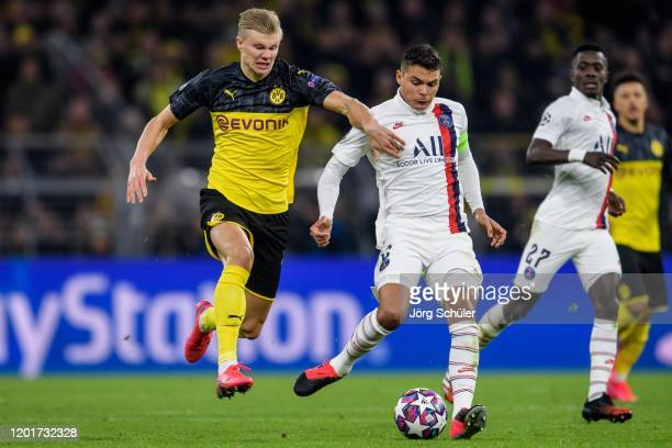 Thiago Silva of Parisis challenged by Erling Haaland of Dortmund during the UEFA Champions League round of 16 first leg match between Borussia...