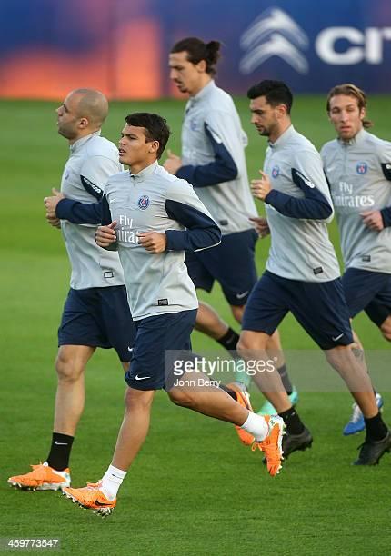 Thiago Silva of PSG along Alex Dias Da Costa Zlatan Ibrahimovic Javier Pastore warm up during day 2 of the Paris SaintGermain Training Camp the Qatar...