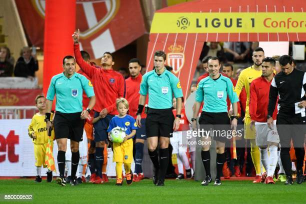 Thiago Silva of PSG and the referee Francois Letexier and his assistants Cyril Mugnier and Mehdi Rahmouni during the Ligue 1 match between AS Monaco...