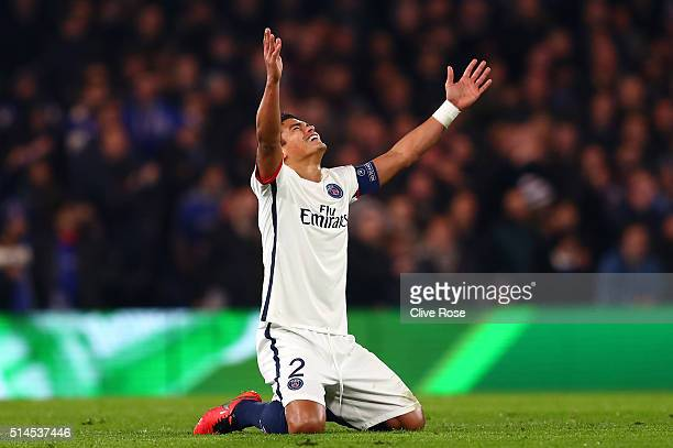 Thiago Silva of PSG celebrates after teammate Zlatan Ibrahimovic of PSG scores their second goal during the UEFA Champions League round of 16 second...