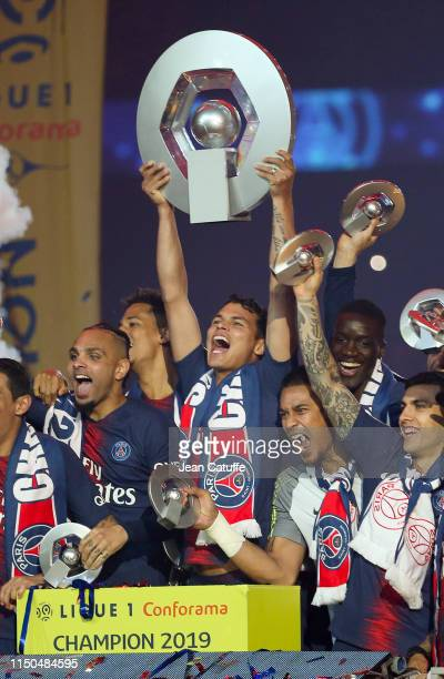 Thiago Silva of PSG - holding the trophy - and teammates celebrate the title of 'French Champion 2019' during the trophy ceremony following the...