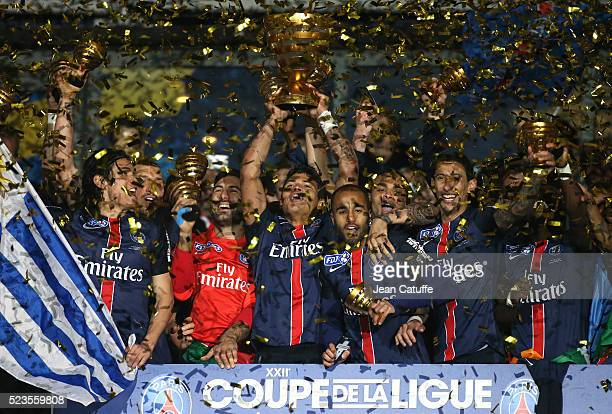Thiago Silva of PSG holds the trophy while celebrating with teammates Edinson Cavani Salvatore Sirigu Lucas Moura Angel Di Maria winning the French...