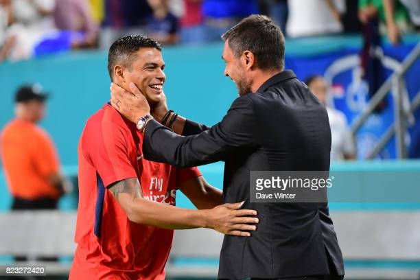 Thiago Silva of PSG is greeted by former Milan team mate Paolo Maldini during the International Champions Cup match between Paris Saint Germain and...
