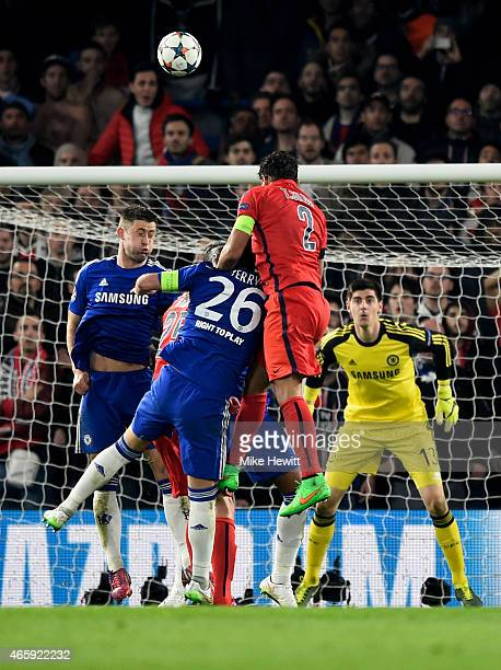 Thiago Silva of PSG rises above John Terry of Chelsea to score a goal to level the scores at 22 during the UEFA Champions League Round of 16 second...