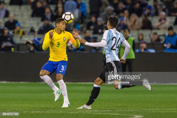 Thiago Silva of the Brazilian National Football Team heads the ball in front of Carlos Joaquin Correa of the Argentinan National Football Team during...
