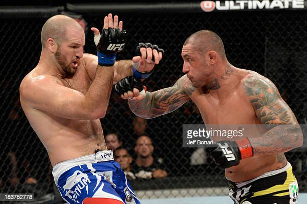 Thiago Silva punches Matt Hamill in their light heavyweight bout during the UFC Fight Night event at the Ginasio Jose Correa on October 9, 2013 in...