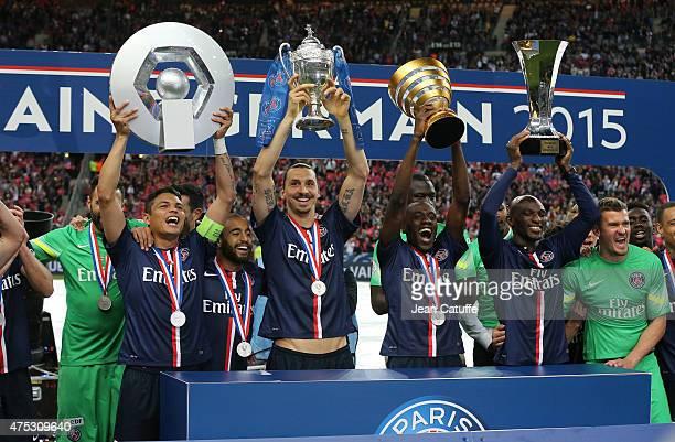 Thiago Silva, Zlatan Ibrahimovic, Blaise Matuidi and Zoumana Camara of PSG lift the 4 trophies PSG won this season after the French Cup Final between...